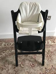 brio black wooden highchair similar to stokke tripp trapp