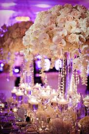 hanging crystals for wedding centerpieces. white rose and orchid centerpiece with hanging crystals for wedding centerpieces