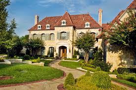 exterior shutters dallas. example of a classic two-story stone exterior home design in dallas shutters e