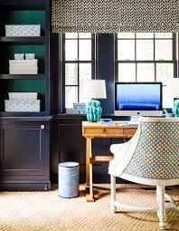 navy built in shelves with backs of shelves lined with emerald green grasscloth