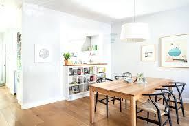 half wall height half wall bookshelf dining room transitional with built in bookshelf transitional bar stools