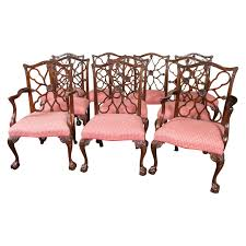 set of ten pendale style carved mahogany wheel back dining chairs for