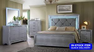 The Charles Bedroom Set Features A Silver Finish With Mirror Accents On All  Case Pieces Along With The Footboard Of The Bed. The Headboard Features  Button ...
