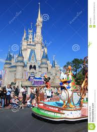 beautiful sunny day in disney world magic kingdom park in orlando and cartoon heros on a parade