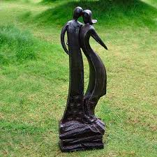 stylish couple modern garden sculpture