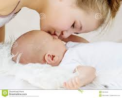 cute little sister kisses newborn