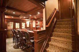 Stairs to this amazing basement with bar and wine cellar