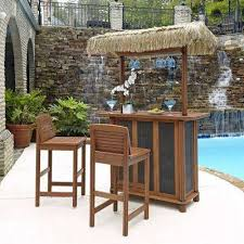 bali hai outdoor patio tiki bar and 2 stools