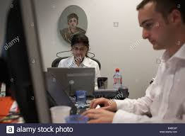 cramped office space. Casually-dressed Accountants Work In A Cluttered Office Cubicle An Auditing Company\u0027s European Headquarters Cramped Space