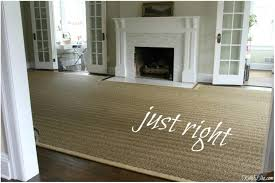 living room with custom rug for fireplace hearth seagrass used design and photography by