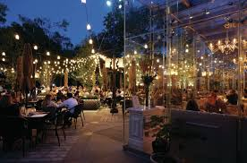 terrace lighting. a new glass pavilion overlooks the courtyard terrace whose signature lighting element is canopy of t
