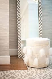 white floor mirror. Gray Bedroom Features Walls Clad In Grasscloth Lined A West Elm Parsons Floor Mirror - Herringbone Alongside White Feather Pouf Ottoman.