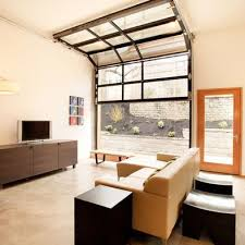 keep garage door for industrial feel; lighting and air - in garage to  living room conversion I like the idea of a glass door/ replace the door  with a large ...