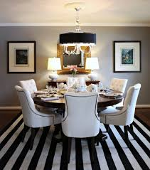 Alluring Dining Space Desaign With White Leather Chair On Streaky Carpet Under Best Lamp