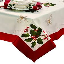 100 polyester imported embroidered table cloth measures 70 inch round choose from embroidered poinsettia or