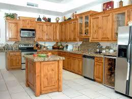 image of oak kitchen cabinets and backsplash