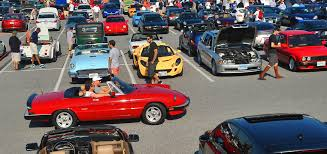 an alpha spider cruises the aisles of the coffee cars gathering at hunt valley towne centre early saay mornings car enthusiasts begin their weekend