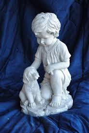 lawn boy statue. boy with dog kneeling lawn statue