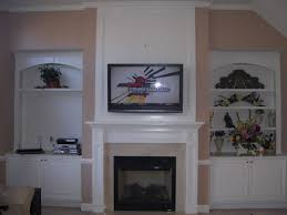 furniture white fireplace under wall mount tv among stained