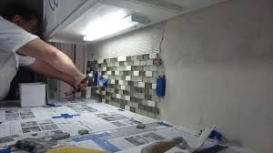 how to install glass mosaic tile backsplash part 2 installing the tile cutting glass mosaic tile