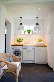 lighting for laundry room. laundry room with pendant lighting farmhouse sink and for folding clothes i like the paneling plus