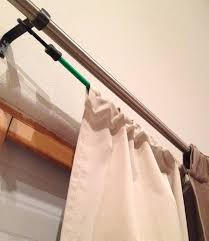 hang two sets of curtains using one rod hang your blackout curtains on a bungee