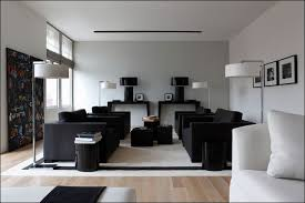 modern lighting living room. Modern Floor Lamps Living Room With Black Fabric Sofa On White Rug Two Chest Tables Lighting I