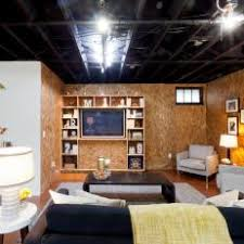 Exposed ceiling lighting basement industrial black Beams Industrial Living Room With Exposed Ceiling And Unfinished Walls Photos Hgtv Photos Hgtv