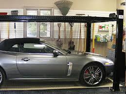 garage inside with car. Auto / Car Lift, 4 Post - Garage Slatwall Organizers, Workstation, Wall Hooks Inside With