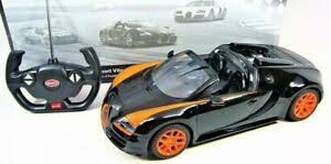 Hier vindt u het huidige bugatti veyron aanbod op autoscout24, europa's grootste online automarkt. 1 14 Rc Bugatti Veyron Grand Sport Vitesse Exotic R C Car Black Orange Roadster Ebay