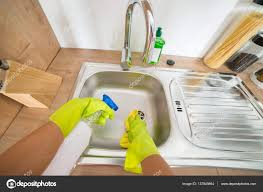 Woman Cleaning Kitchen Sink Stock Photo Andreypopov 137849864
