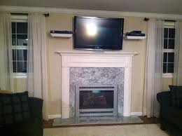 marble fireplace mantel design idea under wall mount with two floating shelves on electric