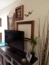 fine art gallery wall with birds and oil paintings in antique frames