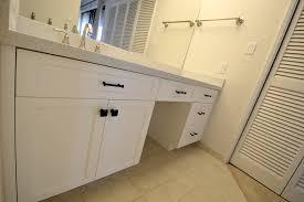 white bathroom cabinets with bronze hardware. high end customer woodwork. white vanity bathroom cabinets with bronze hardware t