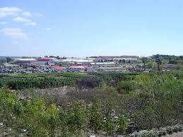 a view of gertens commercial s the buliding in the middle and the gertens retail and greenhouses behind