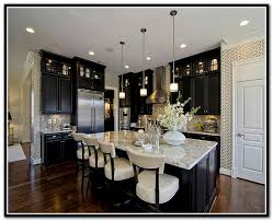 black kitchen cabinets with white marble countertops
