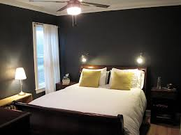 super dark grey wall painted with brown teak wood master bed size added white bedcovers sets also cool fan ceiling lamps in small space master dark bedroom