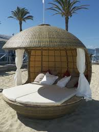 round wicker beach daybed and canopy using white mattras and curtain combined with white