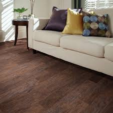 this hand sed dark hickory laminate flooring has an embossed texture that brings out the wood grain look it stands up to heavy residential traffic