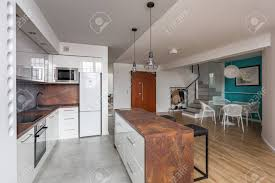 Modern Kitchen With Open Kitchen With Island Dining Table And