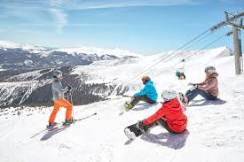 a group of skiiers and riders at breckenridge ski resort