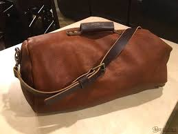 a classic military style top loading clip closure duffle but made with gorgeous full grain pull up leather this duffle is made sy has both modern
