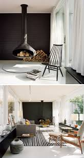 this modern living room features a hanging black fireplace a black tile accent wall
