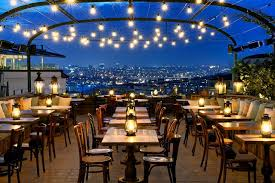 rooftop lighting. atmospheric rooftop dining area lit with hundreds of exposed bulbs at soho house istanbul house lighting o