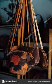 authentic womens leather bags and purses in a handmade hang in the photo by photominus