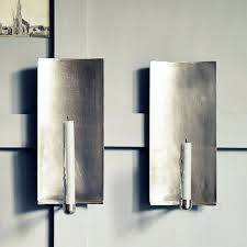 silver wall candle holders above from consortium not on the high street the brushed wall sconce silver wall candle