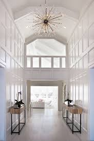 two story foyer chandelier incredible stunning white moulding on walls wood side tables interior design 1