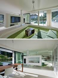 multifunction living room wall system furniture design. The Living Room And Dining In This Home Are Divided By A Partition That On One Side Holds TV Entertainment System, Other Multifunction Wall System Furniture Design