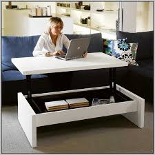 transforming coffee table turning into computer desk with storage area