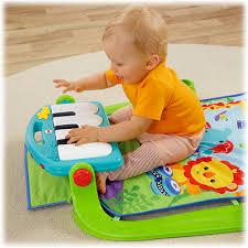 fisher kick n play piano gym sitting at piano